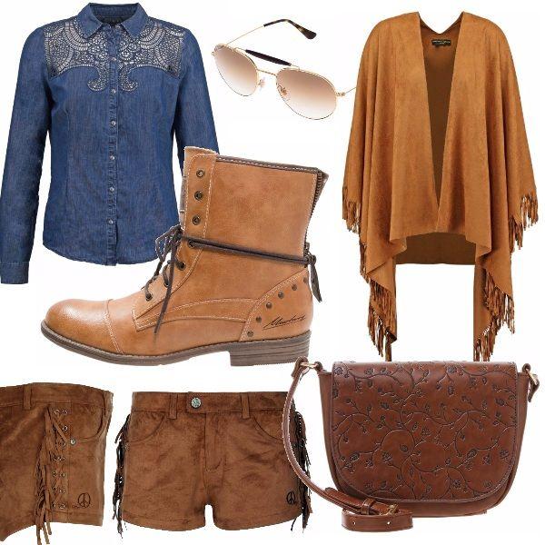 """Cow-girl all'attacco! Questo è un outfit giorno pensato per chi non vuole passare inosservata! Il suo stile un po' """"fuori moda"""", soprattutto se si è in città, attrae gli occhi di tutti per l'estrema stravaganza delle frange. Camicia di jeans con decori sul petto, giacca scamosciata con frange, pantaloni marroni con frange, stivaletti bassi che richiamano il color cognac della giacca, una borsetta tracolla marrone con decori floreali e occhiali per proteggersi dal forte sole del Texas."""