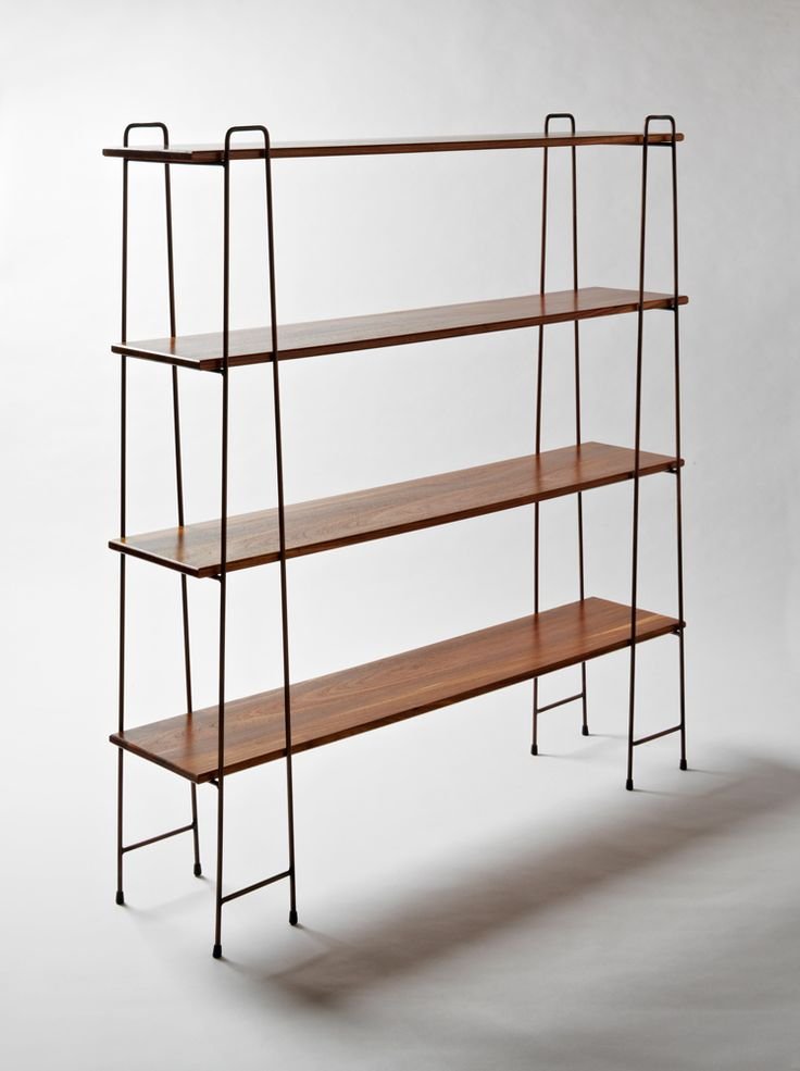 A free standing shelving unit achieves a minimal look, which is honest to its materials and usage. Adjustable and flat packable characteristics encourage easy living, which, true to the brand, distill the design to a functional but basic form.  Materials: Kiaat and Anitque Copper  Dimensions: L 1500mm x W 400mm  x H 1605mm