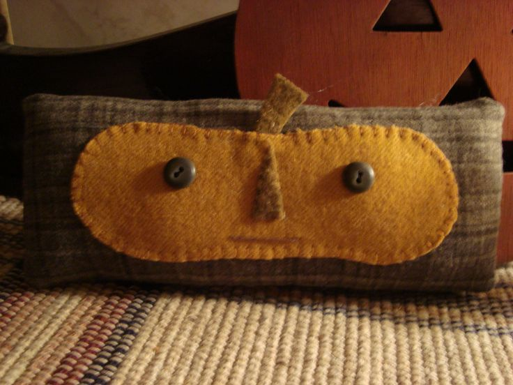 Folky Pumpkin Pillow... Need to make these as door stoppers/draft dogers. Just add a stone or brick inside.