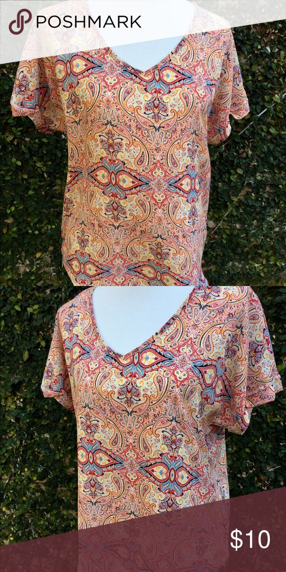 Beautiful patterned lose flowing blouse top Nordstrom Rack purchase, size large, soft, flowing blouse with a beautifully striking pattern. If you are a size medium and like larger flowing shirts this would be fine!! Tops Blouses