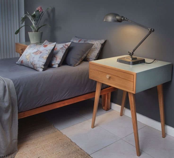 Yellow wood (reclaimed) bedside tables and Cherry wood bed on wooden casters by MARC