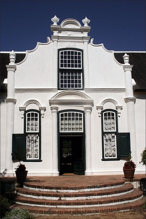 Boschendal Manor and Winery, Franschhoek, South Africa. The building, c. 1812, is a prime example of Cape Dutch architecture. BelAfrique - Your Personal Travel Planner - www.belafrique.com