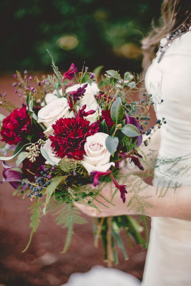 Red carnation, cream rose, fern and berry wedding bouquet | Perfect for a winter wedding!