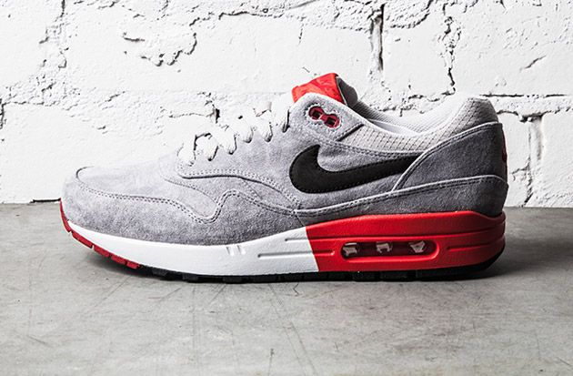 Quickly following up the release of the Nike Air Max 1 Premium in grey/volt, Nike has now dropped a grey/red..