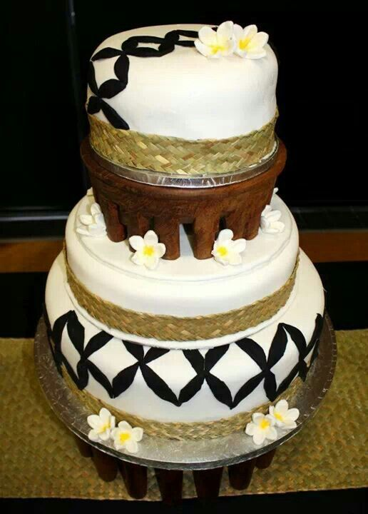 Samoan Wedding Cake, with black flower design, and kava bowl as a stand.