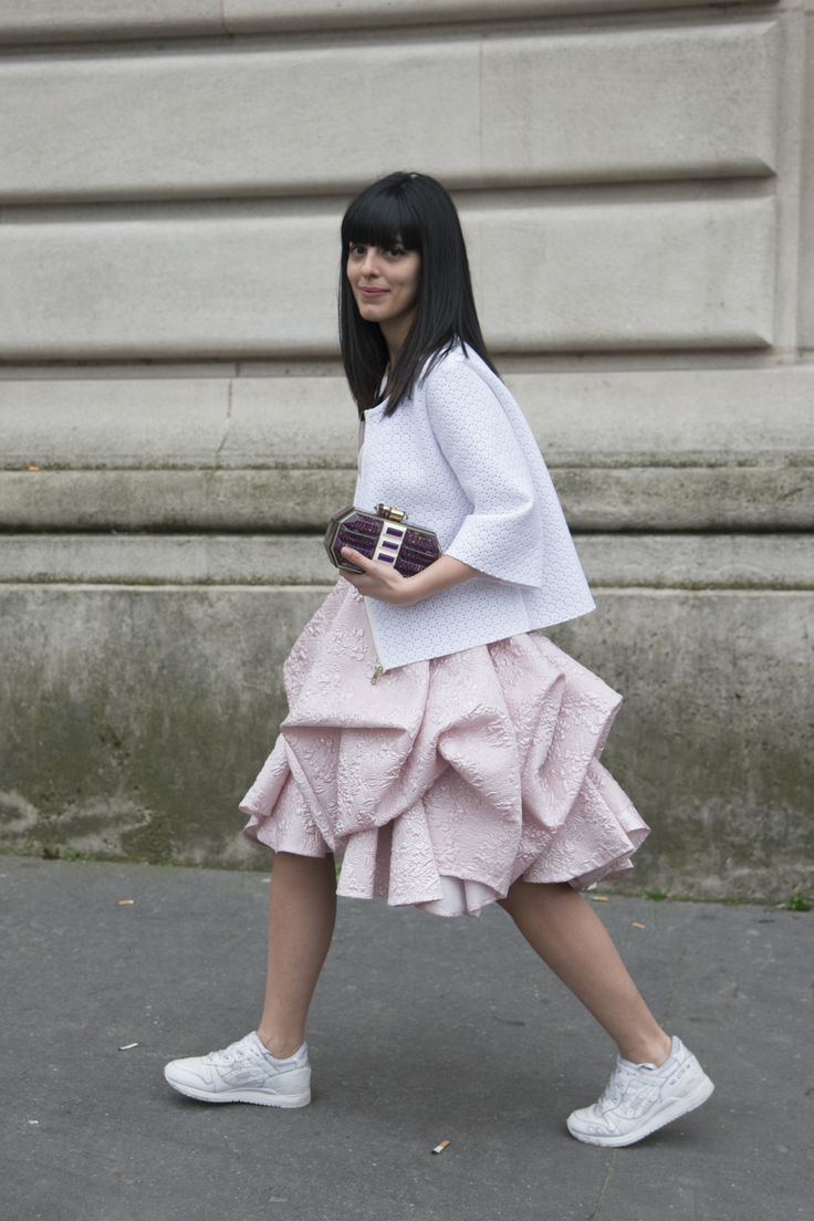 Street Style: Athletic Sneaker Trend - White running sneakers + a fancy voluminous pastel pink skirt. @stylecaster