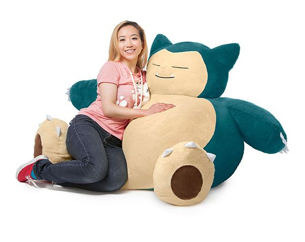 This Pokémon Snorlax Bean Bag Chair looks just like your favorite large Pokemon, Snorlax. This guy is the perfect place to relax after a long day of playing Pokemon Go.  The chair is almost 4 feet tall and over 2 feet wide. Lay back into Snorlax's embrace and chill for a while.    Pok