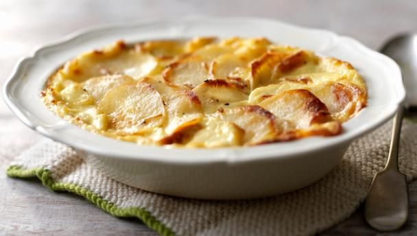 These creamy, garlicky potatoes make a fabulous side dish for any Sunday roast.  Equipment and preparation: You will need a large gratin dish.