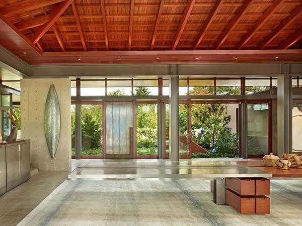 Open glass pavilion house on the shores of Lake Washington