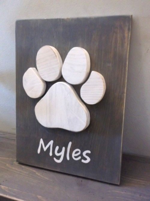 Rustic Wood Paw Print Sign Personalized with your Pet's Name hand painted on the front.  These signs make terrific gifts for dog or cat owners, or as a way to remember a cherished pet that has passed