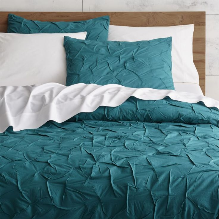 Shop melyssa teal bed linens. An infinite field of hand-guided pintucks creates soft, rippled texture on 100% cotton. Duvet cover fastens with hidden buttons; shams feature envelope closures.