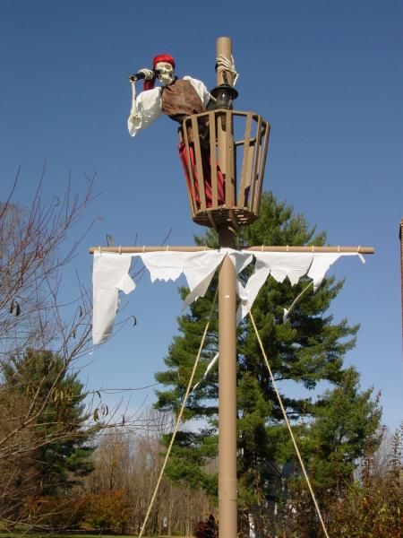 """I used plastic drain pipe for the mast, with PVC pipe booms. The crows nest was 1"""" x 2"""" pine, cut at 22 degree angles and nailed tothether for the frame. I used plaster lathe pieces around that frame and painted them all"""