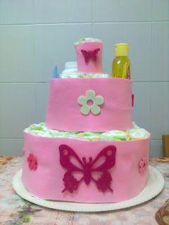 Con pannolini Chicco (misura 4-9 kg.) e rivestita in panno lenci rosa e applicazioni in feltro