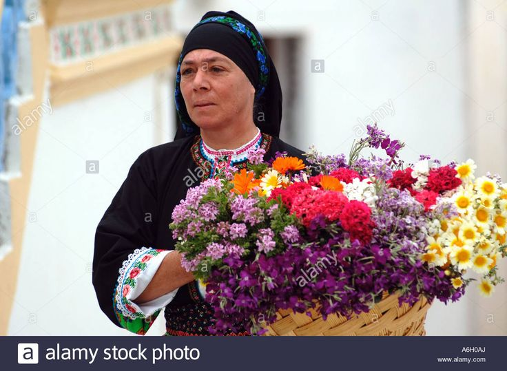 Good Friday Epitaphios  preparation.  Woman holding a basket of flowers. Olympos Karpathos Dodecanese's islands. Greece. Velissarios Voutsas IML Image. www.alamy.com.