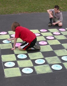 Play Checkers on the Sidewalk - Fun for a less active field day station or a last day of school station!