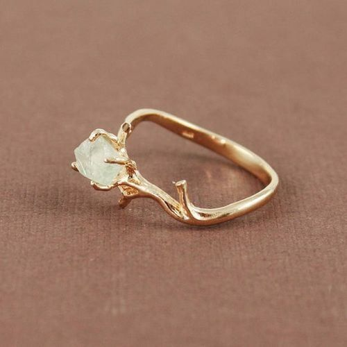 Branch ring with raw unpolished diamond. So gorgeous.