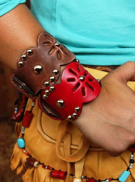 studded leather cuffs...
