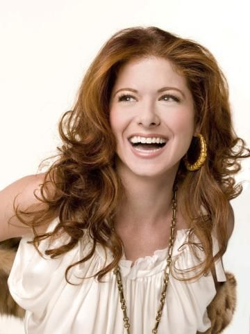 Absolutely adore Debra Messing's hair and makeup in this photograph.