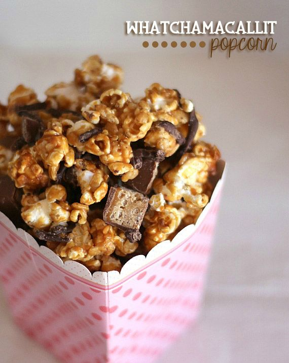 Whatchamacallit Popcorn | Cookies and Cups ~ Peanut Butter Caramel Popcorn drizzled with chocolate and sprinkled with chopped Candy Bars!