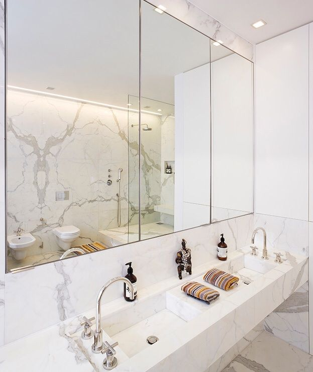 Stone Theatre - bathrooms - calacatta oro marble, floating his and her sinks, his and her sinks, deck mount gooseneck faucet, frameless medi...