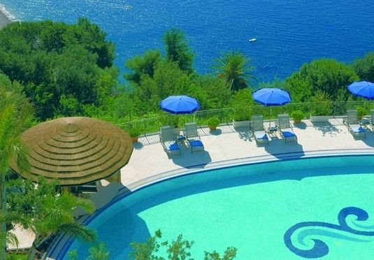 A glamorous five-star hillside hotel and spa on the Amalfi Coast, with sea views, breakfast, complimentary spa access, plus restaurant and treatment discounts