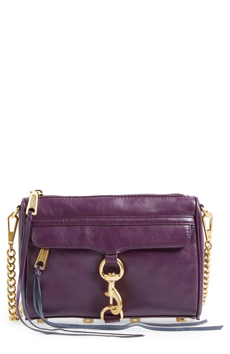 This gorgeous Rebecca Minkoff crossbody in aubergine with gold details adds a splash of color to the ensemble.