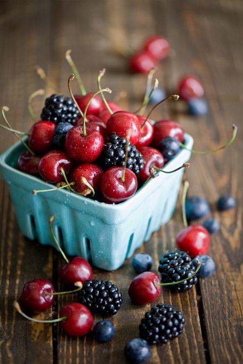 The rich colours of berries - blueberries, goji berries & raspberries