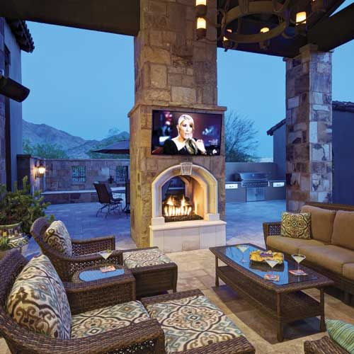 This open air living room is gorgeous complete with a two for Open sided fireplace