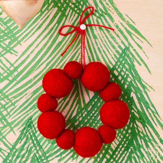 This simple wreath ornament made with felted wool balls comes together quickly, so it's easy to make multiples for a cohesive look on your tree.