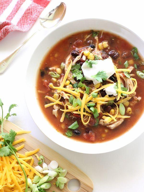 Slow Cooker Chicken Enchilada Soup #recipe on foodiecrush.com