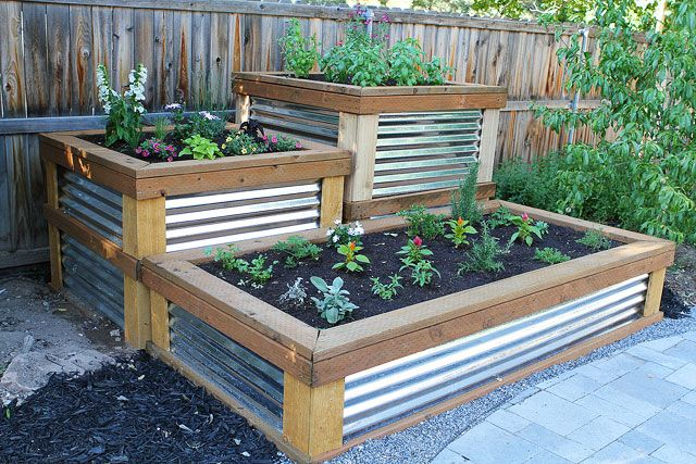 To build the raised herb garden, the pinner's husband used pressure treated 2×4′s, 2×6′s, and 4×4′s. He built the frame out of the pressure treated wood. He use corrugated aluminum roofing to side the raised beds. To trim the sides, he used cedar fencing. Josh bought all of these materials at Lowe's. - Source: Two Peas and Their Pod. IMPORTANT HEALTH NOTE: Avoid pressure treated wood with CCA-chromated copper arsenate (arsenic)