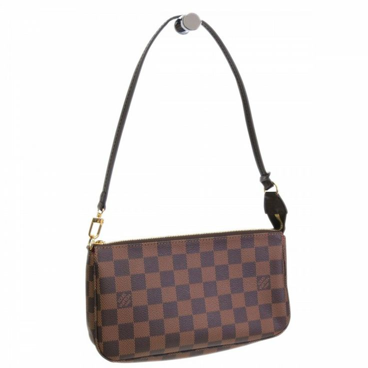 Find this authentic LOUIS VUITTON Pochette Accessories Bag made from toile damier canvas on SWAYY. The interior opens to a red textile. It features brown leather trim and can either be hand-held or linked to the D-ring common with many of the collections. It easily carries all your little essentials. https://www.swayy.com.au/handbags/louis-vuitton-pochette-damier-ebene-accessories-bag.html