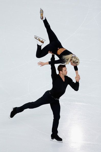 Dylan Moscovitch and Kirsten Moore Towers of Canada practice during Figure Skating Pairs training ahead of the Sochi 2014 Winter Olympics at...