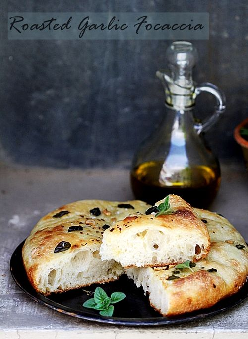 Roasted Garlic Focaccia...It's simple, is ready to bake in a couple of hours, and the olive oil lavished on top gives it a beautiful crust.