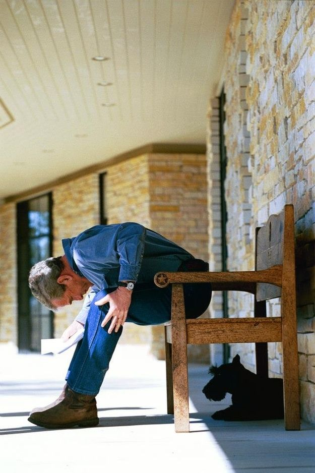 George W. Bush looks at his dog Barney while on his ranch:
