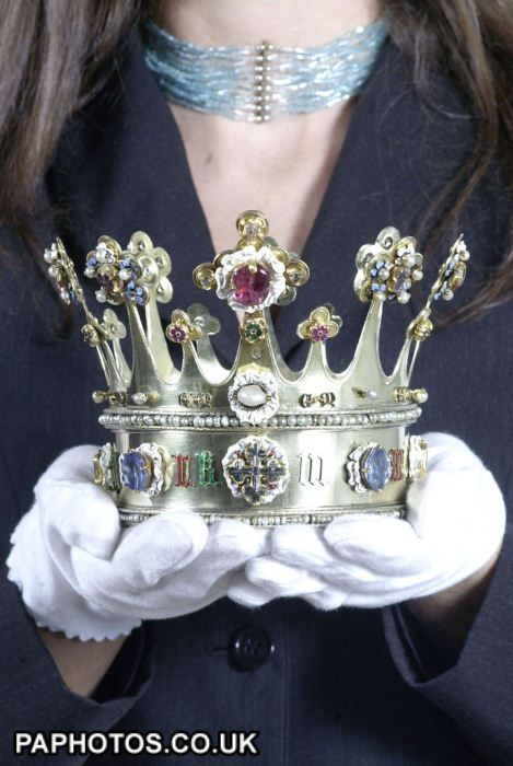 Assistant Curator at the Tower of London, Anna Keay, holds the 15th century crown of Margaret of York. Exhibition held in the Tower of London in celebration of the Queen's Golden Jubilee. The crown left England in 1468 and is one of only two English Medieval crowns that survived the Civil War and is now kept in Aachen Cathedral in Germany. http://www.MemoryMakerTravelResource.com