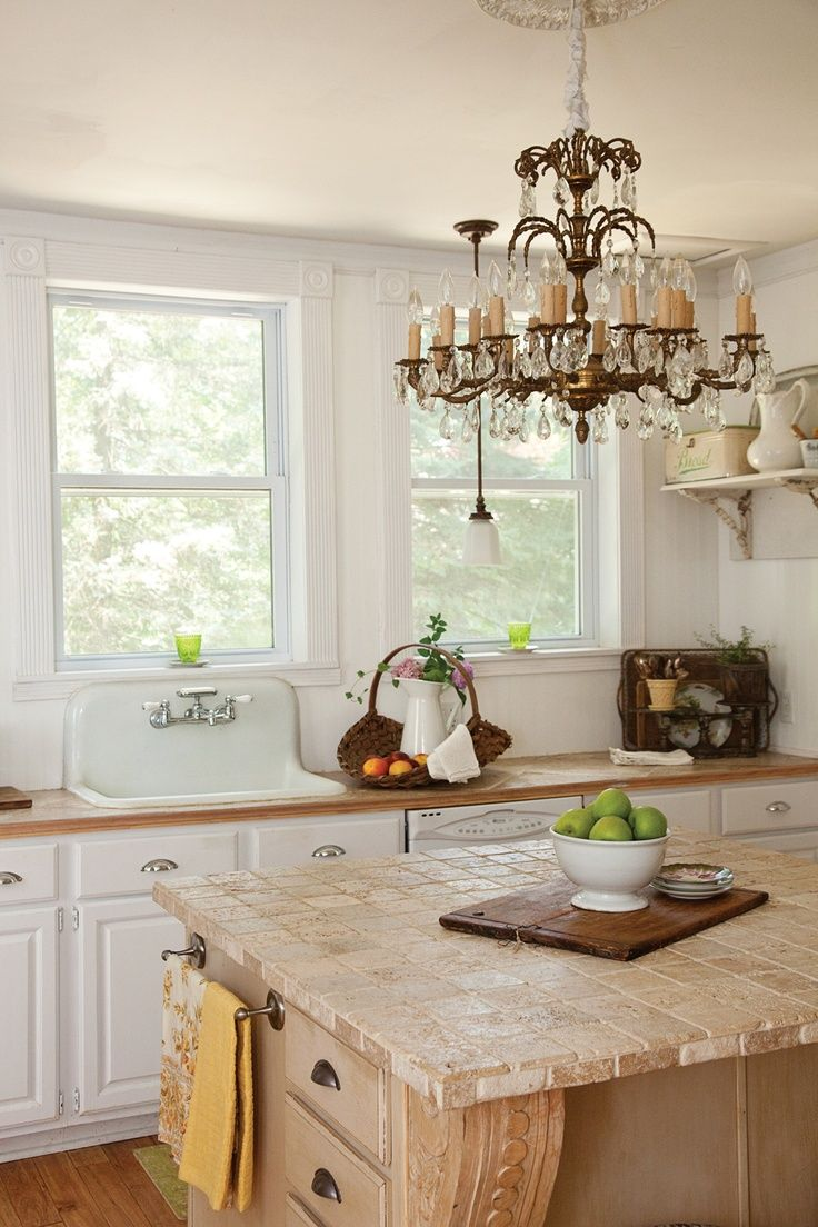 Vintage Italian Crystal Chandelier over Island in Kitchen. Love the farmhouse sink & rustic island!