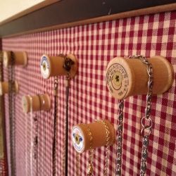 Create a necklace display using vintage spools.