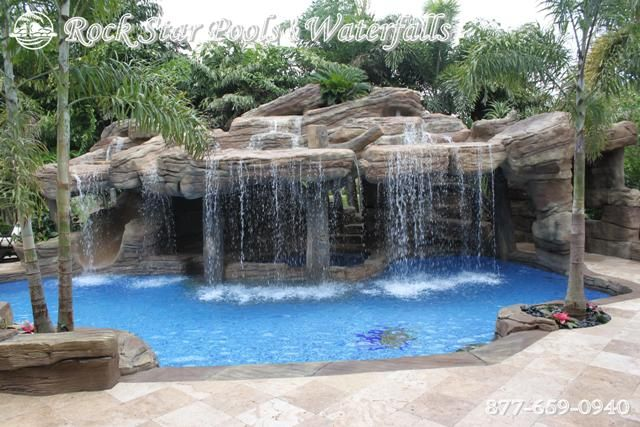 Love the waterfall which hides the grotto and the slide for Swimming pools with slides and waterfalls