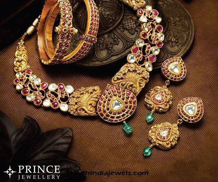 Antique gold necklace, earrings and bangles designs from Prince Jewellery. The jewelleries are studded with kemp rubies and white stones.