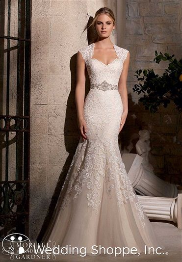 Lace fit and flare wedding dress with cap sleeves. Mori Lee Bridal Gown 2719