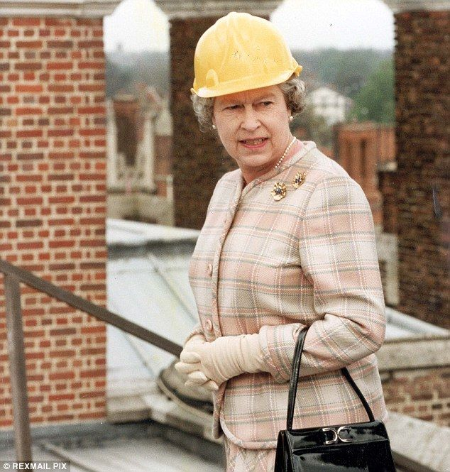 The Queen, pictured in Hampton Court in 1991 inspecting the repairs following the fire is reluctant to leave Buckingham Palace while her home undergoes a £150million refurbishment