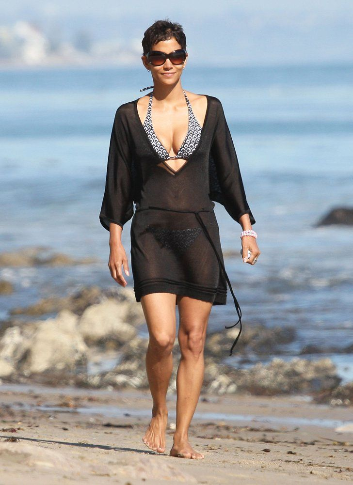 Pin for Later: Halle Berry's Hottest Bikini Moments!  Halle covered up her bikini in Malibu during April 2011.