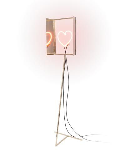 Altarino, a unique item inspired by medieval votive shrines, was created by Dozen Design. It features a golden metal shrine that preserves, protects and displays a handmade glass tube, shaped like a stylised heart, loaded with neon gas. A magnetic neon sign transformer is included.
