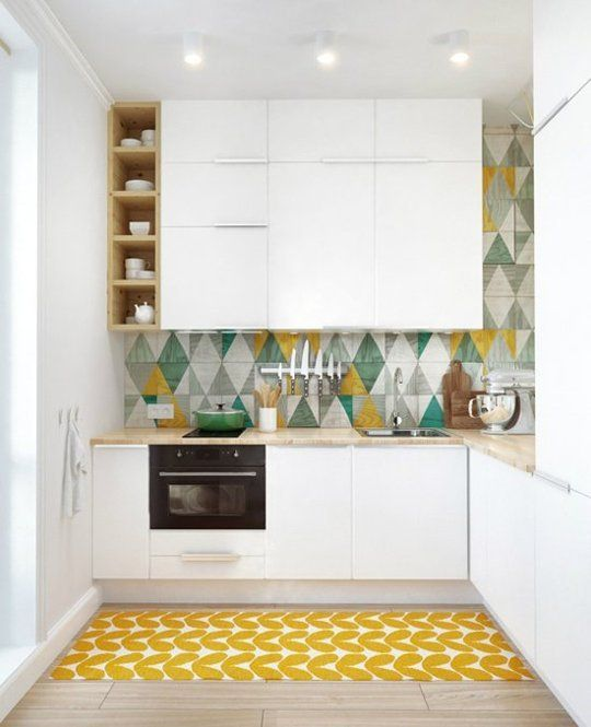 5 Tiny Kitchens with Style | Apartment Therapy. love the patterned tile splash back, the small open cubbies on the side to display pieces and the rug on the floor.