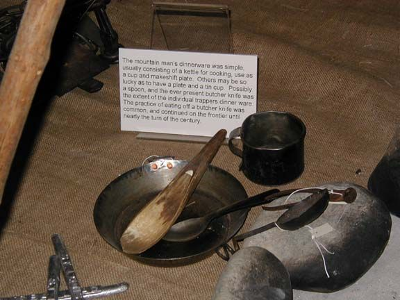 The mountain man's dinnerware was simple, usually consisting of a kettle for cooking. Others may be so lucky as to have a plate, a tin cup, possibly a spoon, and the ever present butcher knife. This was the extent of the individual trappers' dinner-ware. The practice of eating off a butcher knife was common and continued on the frontier until nearly the turn of the century.: Men Dinnerware, Tins Cups, Individual Trapper, Butcher Knifes, Mountain Men'S, Mountain Man, Trapper Mountain Men, Bush Fire Camps, Mtn Men