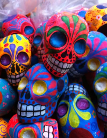 Dia de los Muertos - Day of the Dead - Celebration for gathering and pray and remember friends and loved ones who have passed on. Takes place November 1, in connection with the Catholic holidays of All Saints' Day and All Souls' Day (November 2). Celebration filled with bright color decorations including the popular sugar skulls.