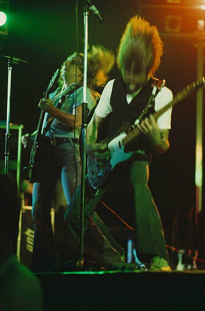 Rick Parfitt Francis Rossi of Status Quo perform on stage London 1975