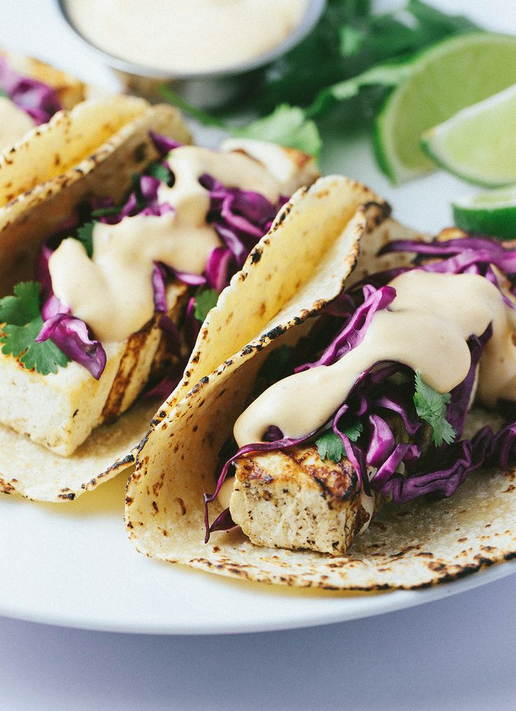 GRILLED BAHA TOFU TACOS + RED CABBAGE SLAW... Perfectly grilled tofu on a warm corn tortilla, topped with a zesty red cabbage slaw and creamy chipotle sauce... so easy and delicious!