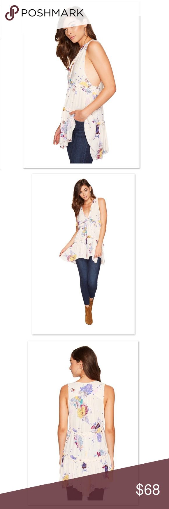 Free People Floral Tunic Spring into fab fashion in this Free People™ Purple Haze Printed Tunic. Tunic boasts a chic pattern on a lightweight fabrication. Flattering empire silhouette Free People Tops Tunics